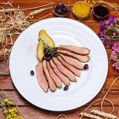 Duck with pear and cherry flambe