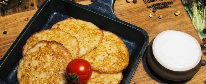 Traditional potato pancakes with sour cream