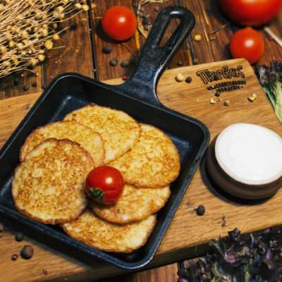 Traditional potato pancakes with sour cream