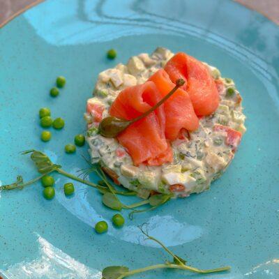 Salad Olivie with salted salmon