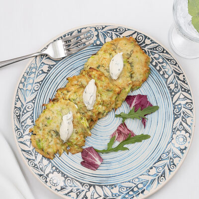 Zucchini pancakes with soft cheese and mint